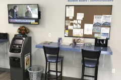 Wall mounted Televisions with plenty of comfortable seating while you wait.